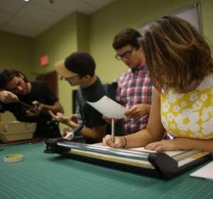 Students work in the studio area.